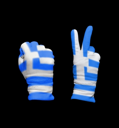 Clenched fist in leather glove, and hand with victory gesture in a glove decorated with Greece flag photo