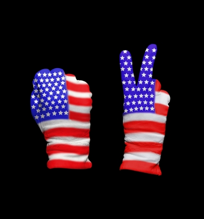 Clenched fist in leather glove, and hand with victory gesture in a glove decorated with USA flag photo
