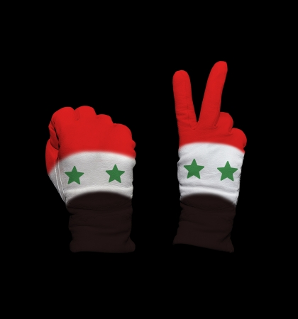 syria peace: Clenched fist in leather glove, and hand with victory gesture in a glove decorated with Syria flag