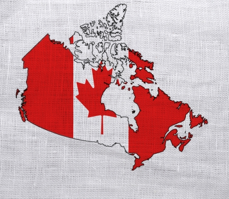 Flag of Canada on a sackcloth background photo