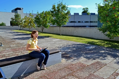 Pensice student girl sitting on the bench with laptop Stock Photo - 14797956