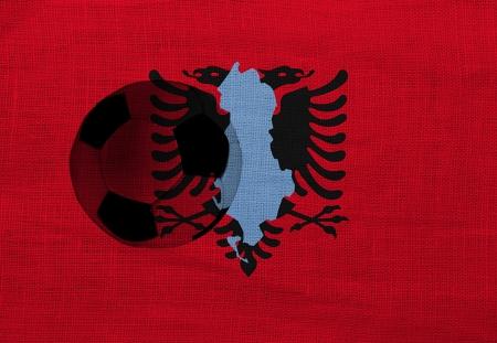 Football ball on the national flag of Albania photo
