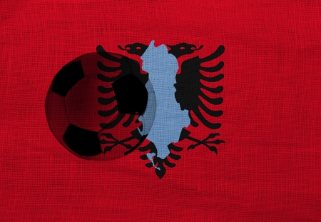 albanian: Football ball on the national flag of Albania