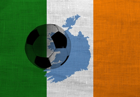 Football ball on the national flag of Ireland photo