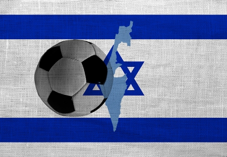 Football ball on the national flag of Israel photo