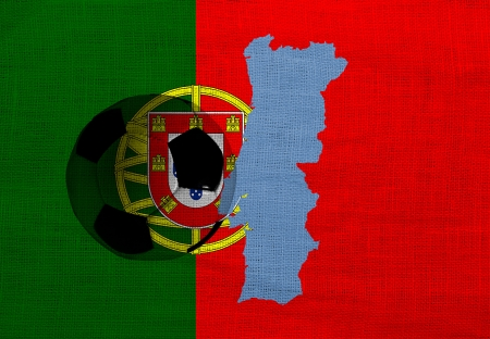 Football ball on the national flag of Portugal photo
