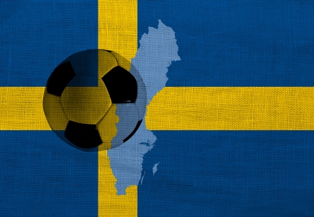 Football ball on the national flag of Sweden photo
