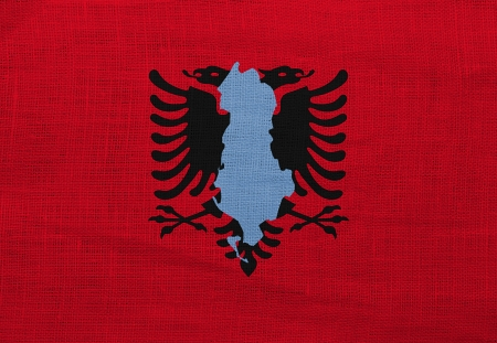 Flag and map of Albania on a sackcloth photo