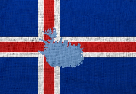 Flag and map of Iceland on a sackcloth photo