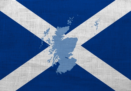 Flag and map of Scotland on a sackcloth photo