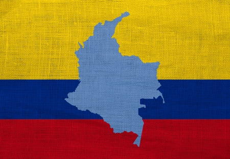 Flag and map of Colombia on a sackcloth photo