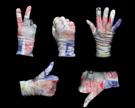 Hands in white gloves wrapped with UK pounds background photo