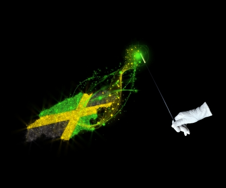 jamaican: Magic wand and the Jamaican flag on a black background Stock Photo