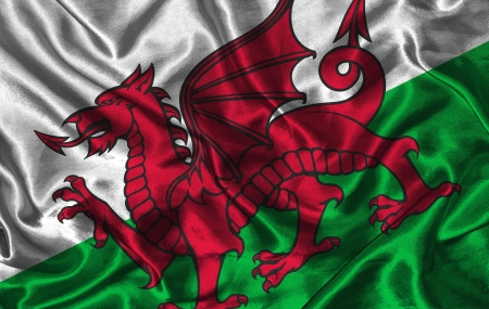 welsh: Waving colorful Welsh flag on a silk background