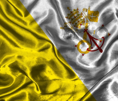 Waving colorful Vatican flag on a silk background Stock Photo