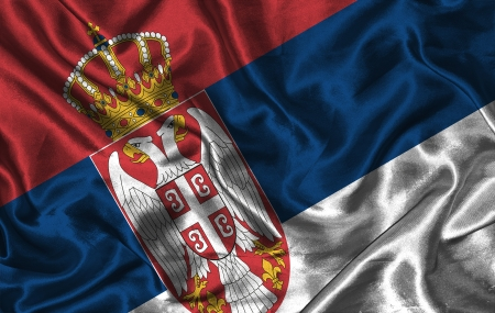 pennon: Waving colorful Serbian flag on a silk background