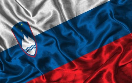 slovenian: Waving colorful Slovenian flag on a silk background