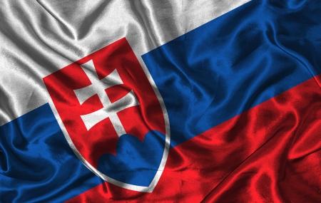 slovak: Waving colorful Slovak flag on a silk background Stock Photo