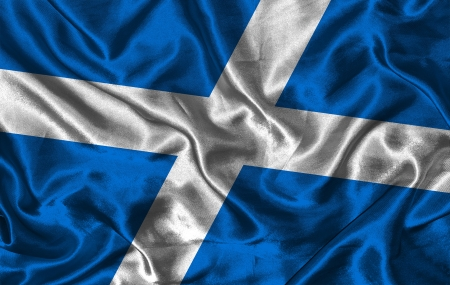 Waving colourful Scottish flag on a silk background photo