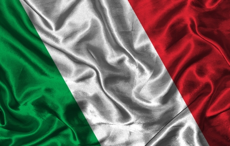 Waving colorful Italian flag on a silk background photo