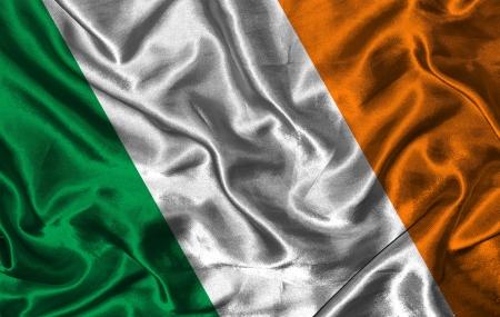 irish pride: Waving colorful Irish flag on a silk background Stock Photo