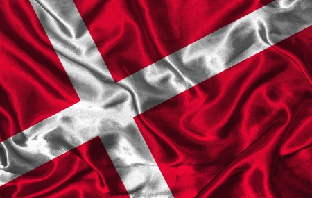 danish flag: Waving colorful Danish flag on a silk background Stock Photo