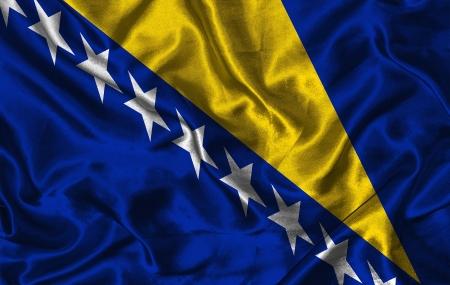bosnian: Waving colorful Bosnian flag on a silk background
