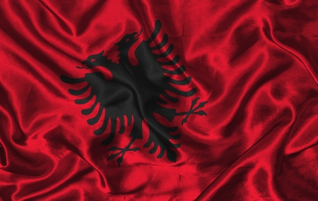 Waving colorful Albanian flag on a silk background photo