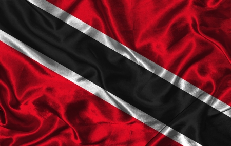 Waving colorful Trinidad and Tobago flag on a silk background photo