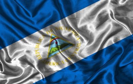 Waving colorful Nicaragua flag on a silk background photo