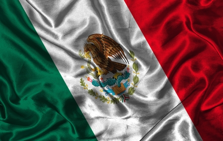 Waving colorful Mexico flag on a silk background photo