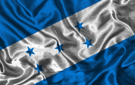bandera honduras: Saludar con la mano colorida bandera de Honduras en un fondo de seda Foto de archivo
