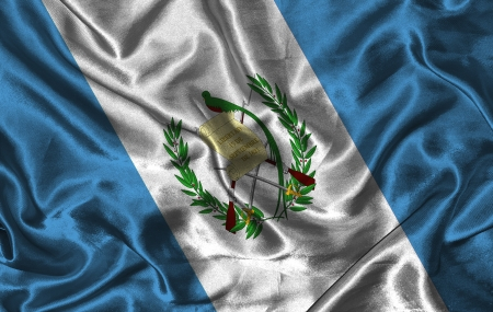 Waving colorful Guatemala flag on a silk background photo