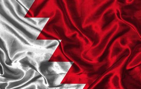 pennon: Waving colorful Bahrain flag on a silk background Stock Photo