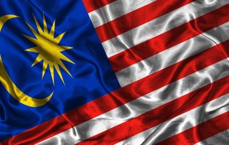 Waving colorful Malaysia flag on a silk background photo