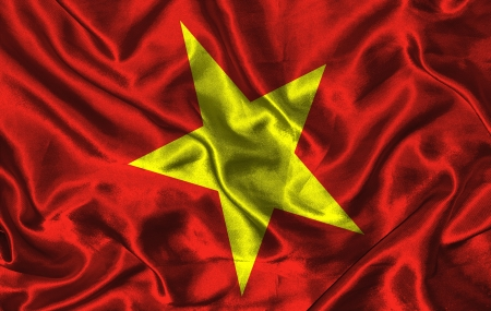 Waving colorful Vietnam flag on a silk background photo
