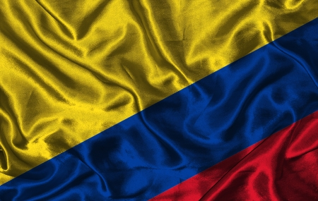 colorific: Waving colorful Colombia flag on a silk background Stock Photo