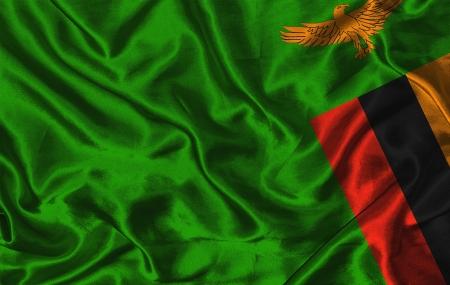 zambia: Waving colorful Zambia flag on a silk background Stock Photo