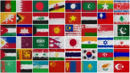Painted Flags of Asia at the cracked wall Stock Photo - 16876961