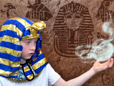 arcane: Portrait of a boy pharao on a stoned wall background Stock Photo