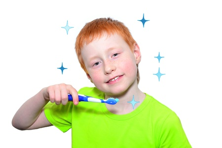 Funny boy in a green tshirt brushing his teeth Stock Photo
