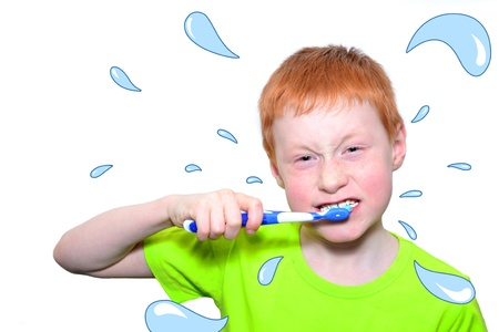snowwhite: Funny boy in a green tshirt violently brushing his teeth Stock Photo