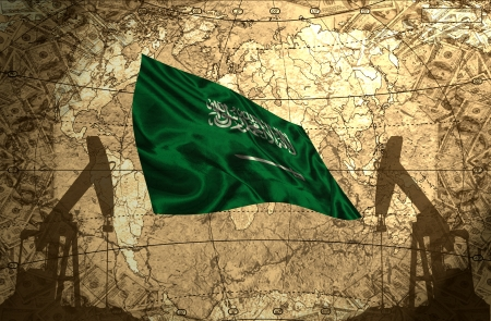 fuel provider: Saudi Arabia flag on the background of the world map with oil derricks and money Stock Photo
