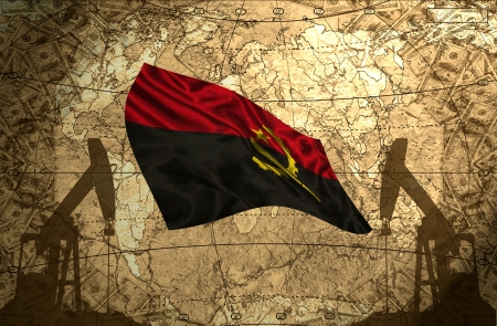 fuel provider: Angola flag on the background of the world map with oil derricks and money