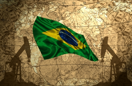 fuel provider: Brazil flag on the background of the world map with oil derricks and money