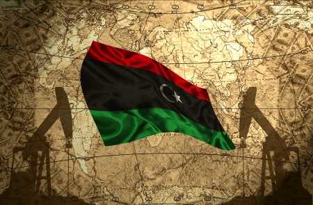 fuel provider: Libya flag on the background of the world map with oil derricks and money