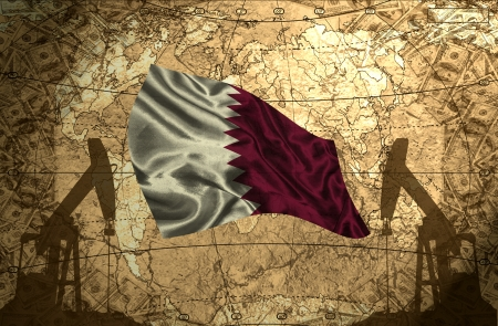 fuel provider: Qatar flag on the background of the world map with oil derricks and money