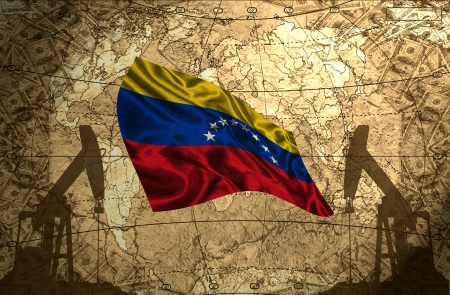 fuel provider: Venezuela flag on the background of the world map with oil derricks and money Stock Photo