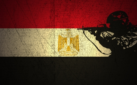 A silhouette of a soldier on the Grunge Egyptian Flag photo