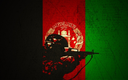 afghan flag: A silhouette of a soldier on the Grunge Afghan Flag